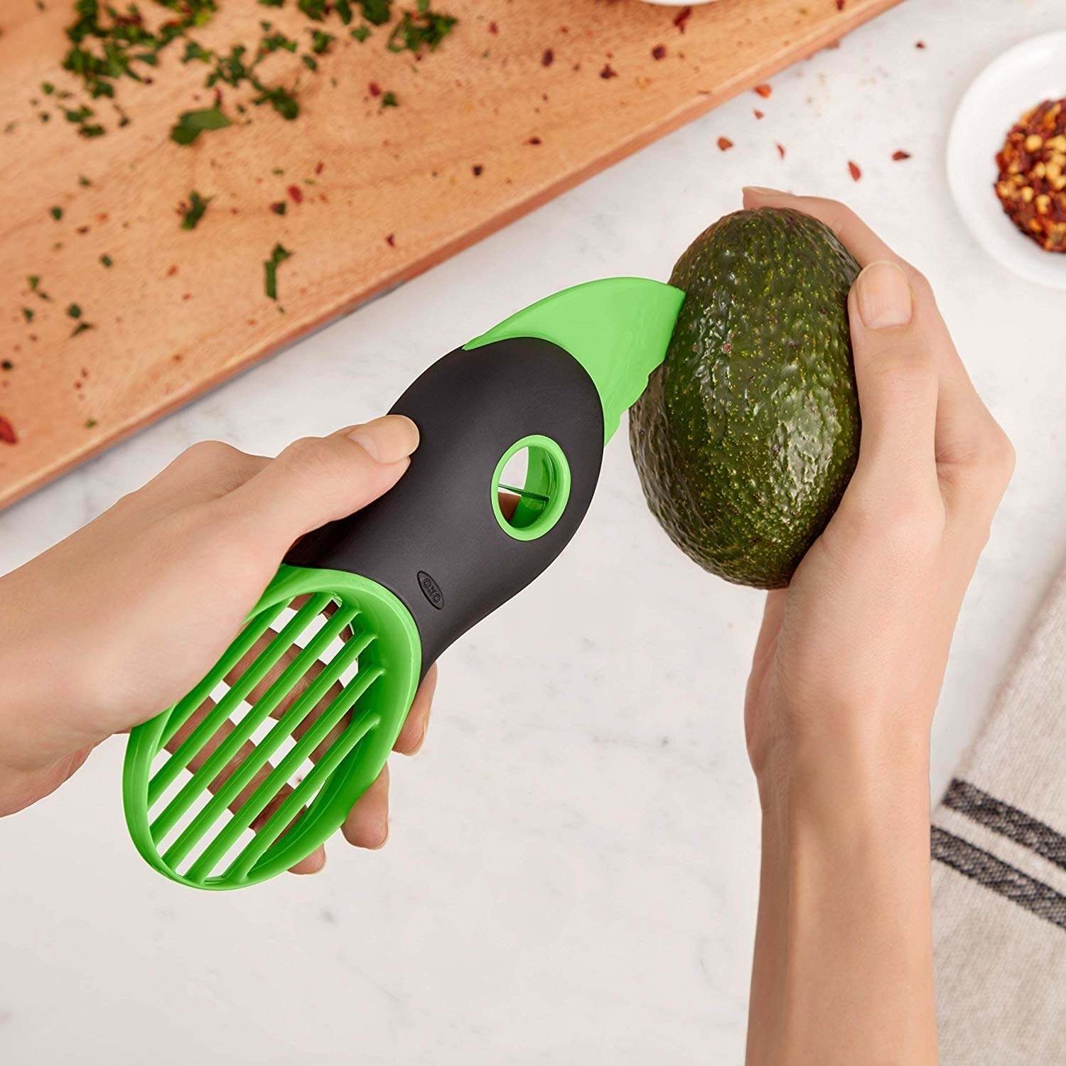 Avocado slicer slicing into avocado