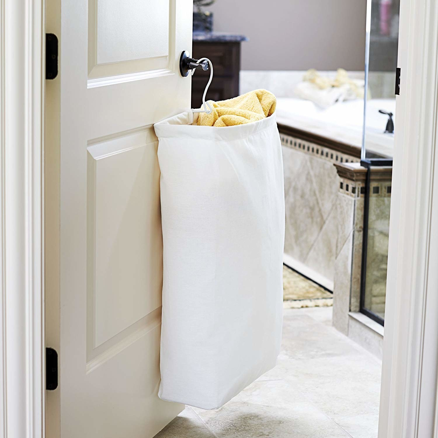 Canvas laundry bag hanging on door knob