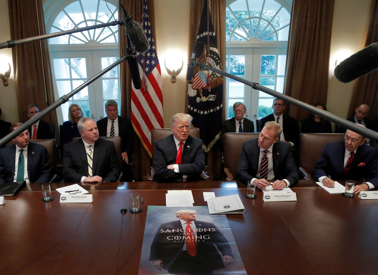 President Trump attends a Cabinet meeting with a poster of himself in the style of the television show Game of Thrones on Day 12 of the partial US government shutdown at the White House on Jan. 2.