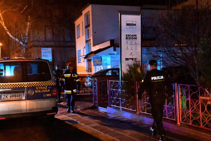 Police secure the scene of the fire in Koszalin, Poland, on Jan. 4.