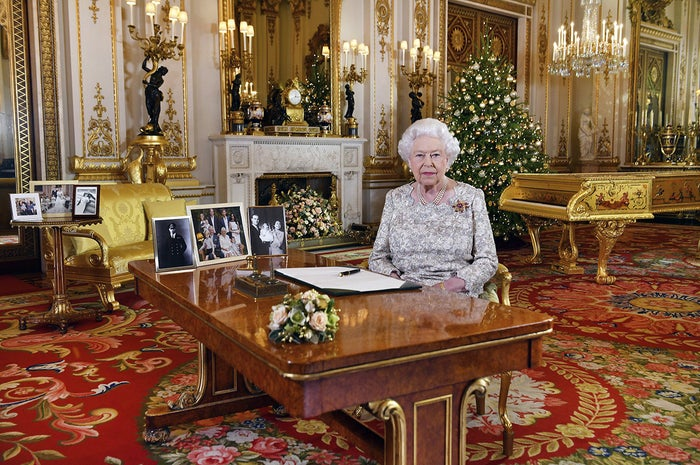 In this image released Dec. 25, Britain's Queen Elizabeth poses for a photograph after recording her annual Christmas Day message, in the White Drawing Room of Buckingham Palace in London.