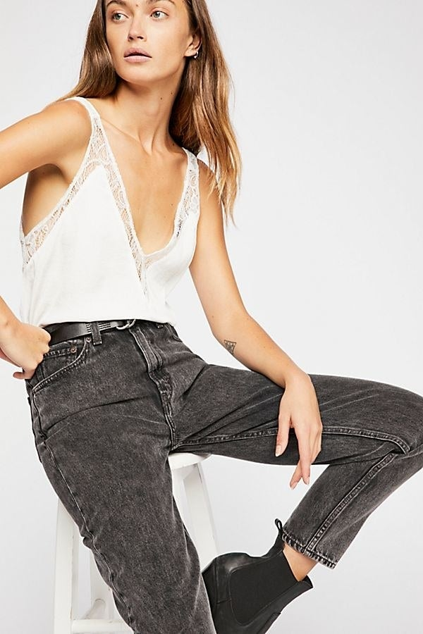 """Get it from Free People for $58 (available in sizes XS–L and six colors).Promising review: """"This is a beautiful, silky, all around perfect cami. I got it in the red, and I would definitely consider getting more. The v-neck and lace details make this particular cami unique and interesting. Love it!!!!"""" —siggielove"""