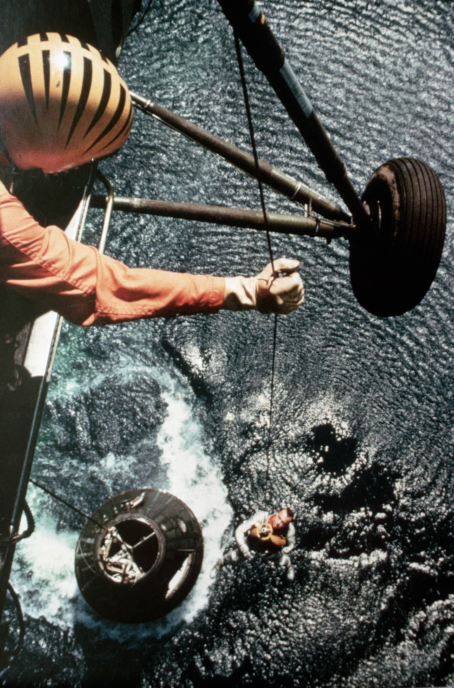 1961 A helicopter lifts Alan Shepard from the Freedom 7 spacecraft over the Atlantic Ocean east of Cape Canaveral.