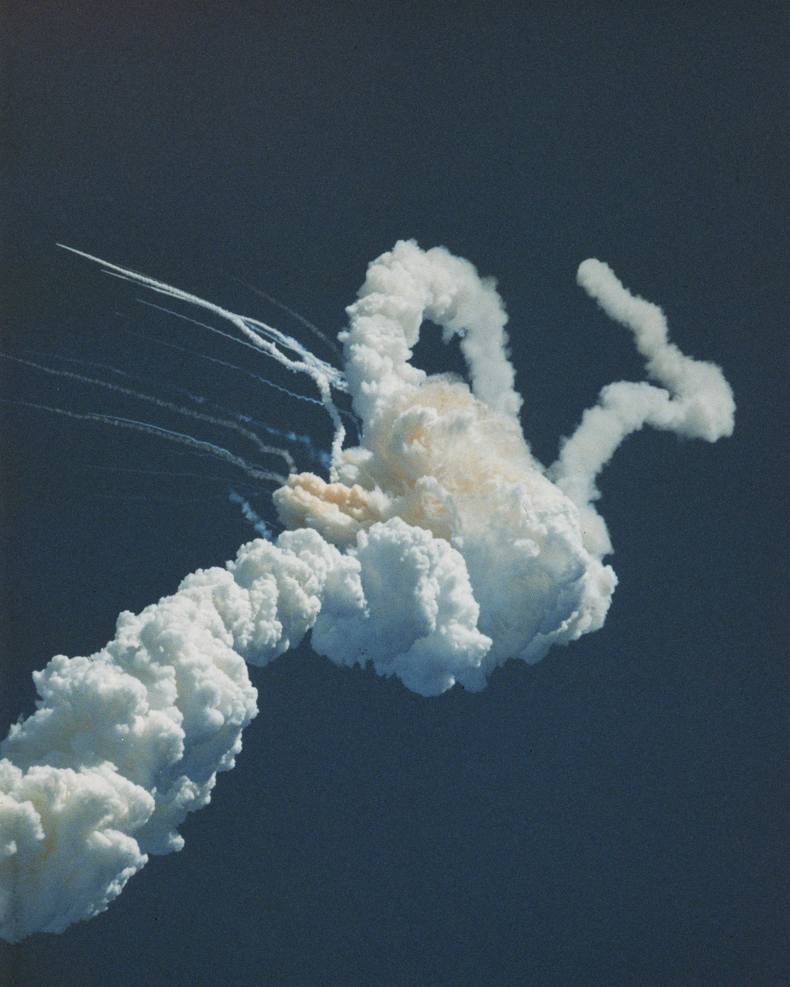 1986 Huge smoke trails resulting from the fatal explosion of the Challenger shuttle 73 seconds after takeoff.