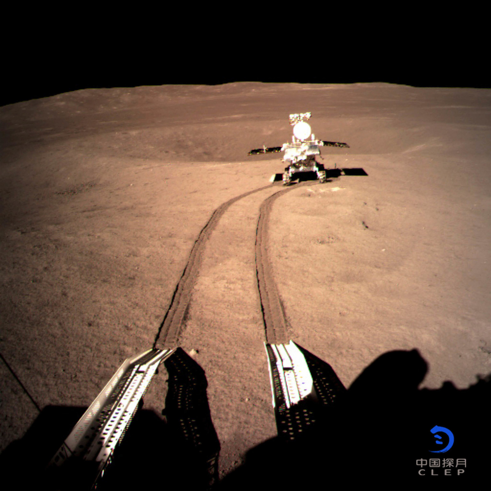 2019 In this photo provided by the China National Space Administration via Xinhua News Agency, Yutu-2, China's lunar rover, leaves wheel marks after leaving the lander that touched down on the surface of the far side of the moon. China's space agency says that all systems are go for its spacecraft and rover, which have made a pioneering landing on the far side of the moon.