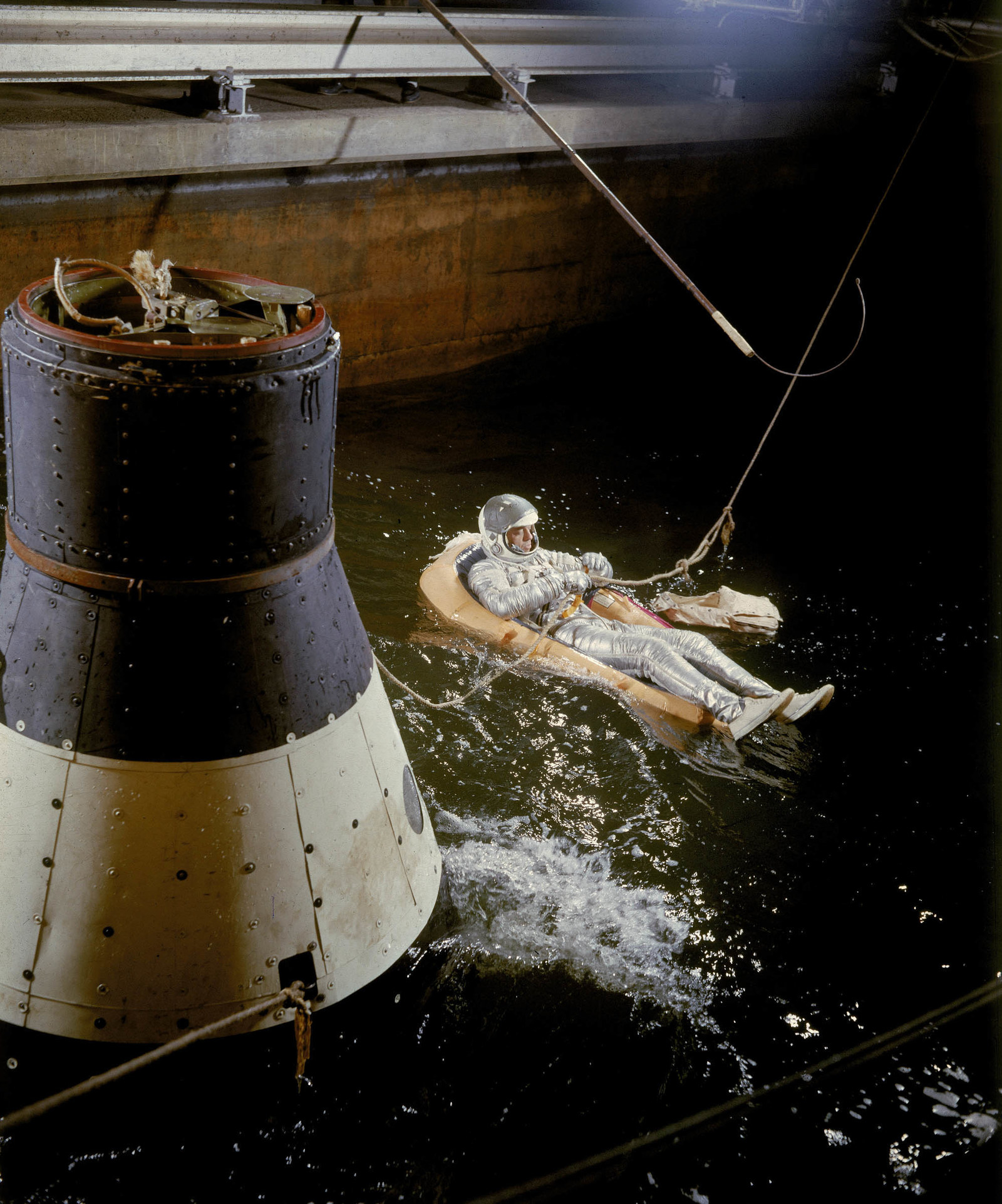 1959 An unidentified Project Mercury astronaut trains in a water tank at Langley Air Force Base, Hampton, Virginia. He is likely practising to escape from the capsule after splashdown.
