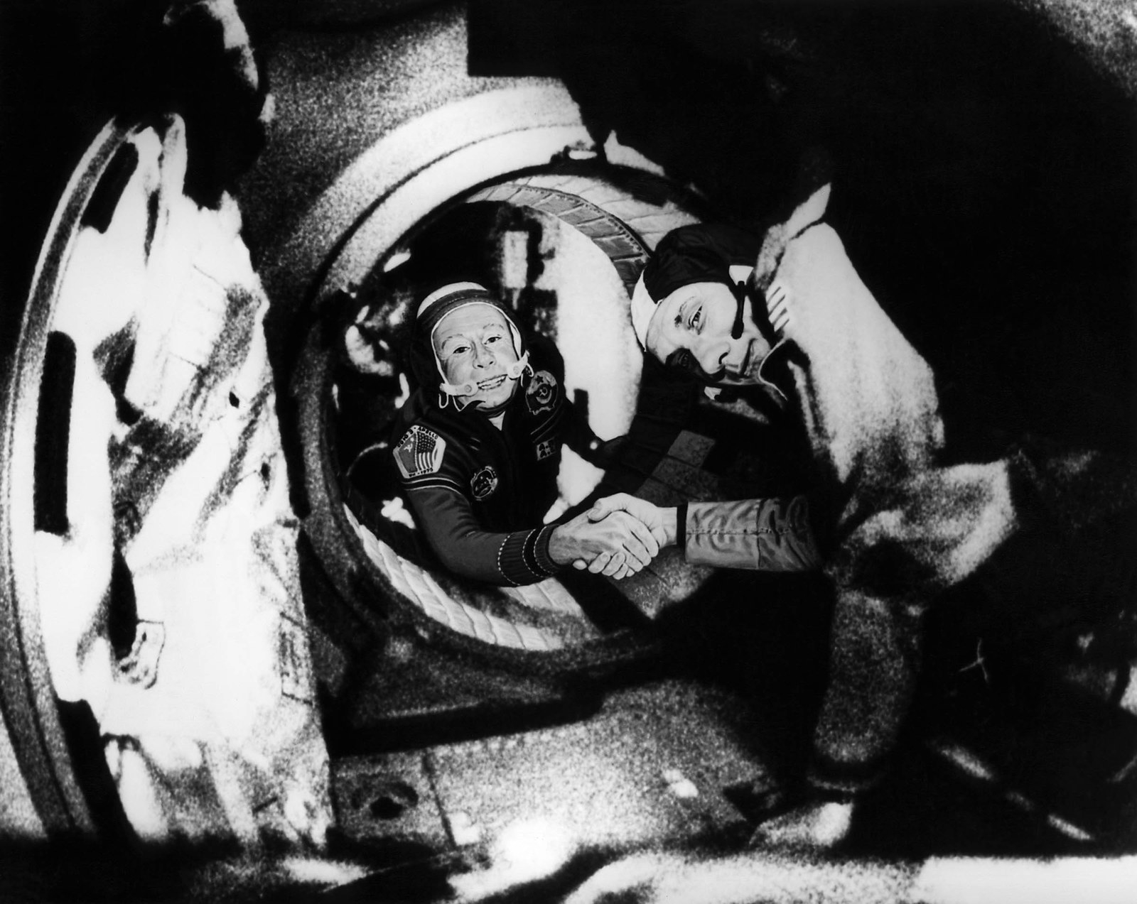 1975 Commander of the Soviet crew of Soyuz Alexei Leonov (left) and commander of the American crew of Apollo Thomas Stafford, shake hands on July 17, 1975, somewhere over Western Germany, after the Apollo–Soyuz docking manoeuvres. This was the first time the two nations met in space — supposedly ending the Space Race that had come before it.
