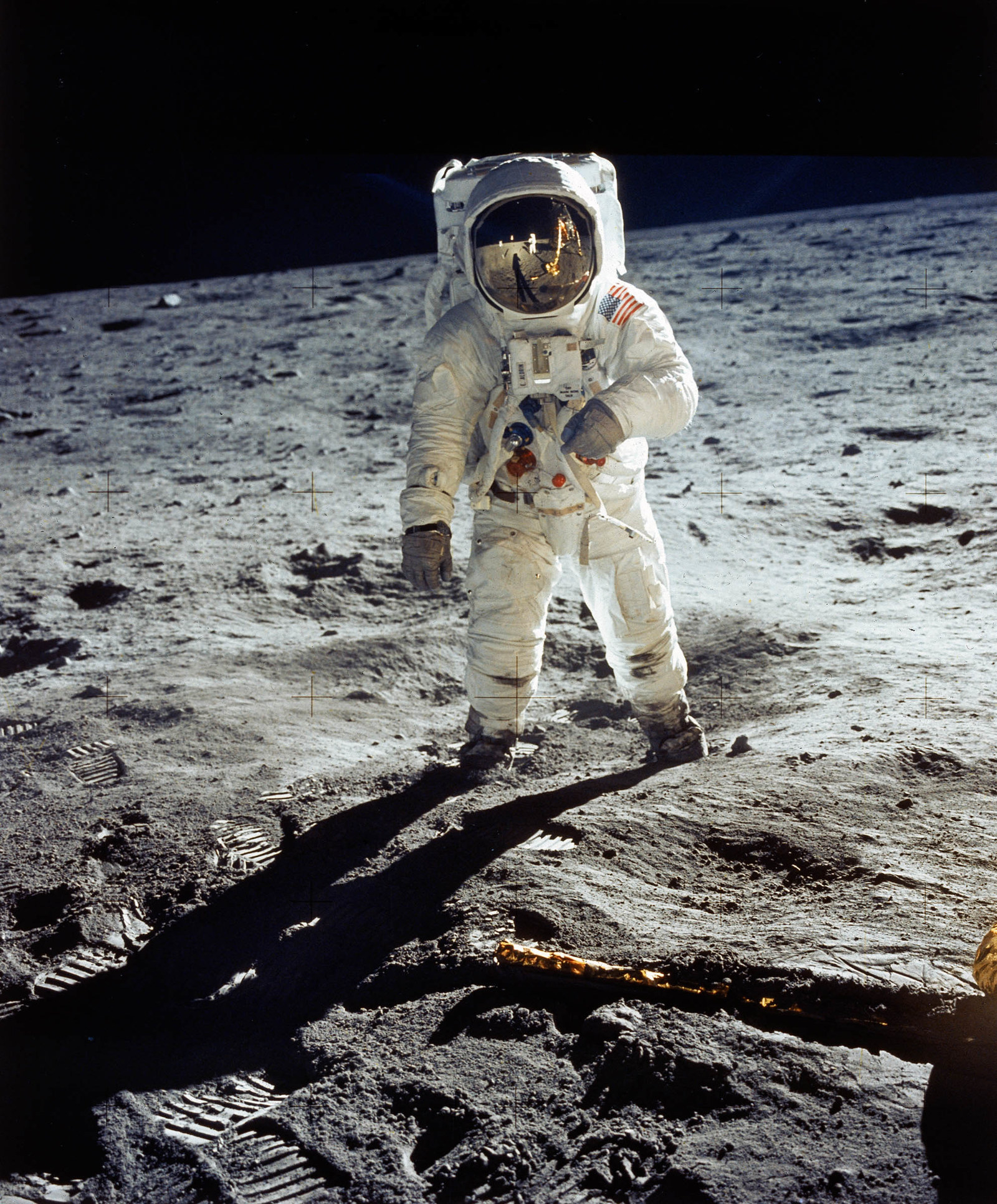1969 Apollo 11 astronaut Buzz Aldrin standing on the moon, with Neil Armstrong reflected in his visor.