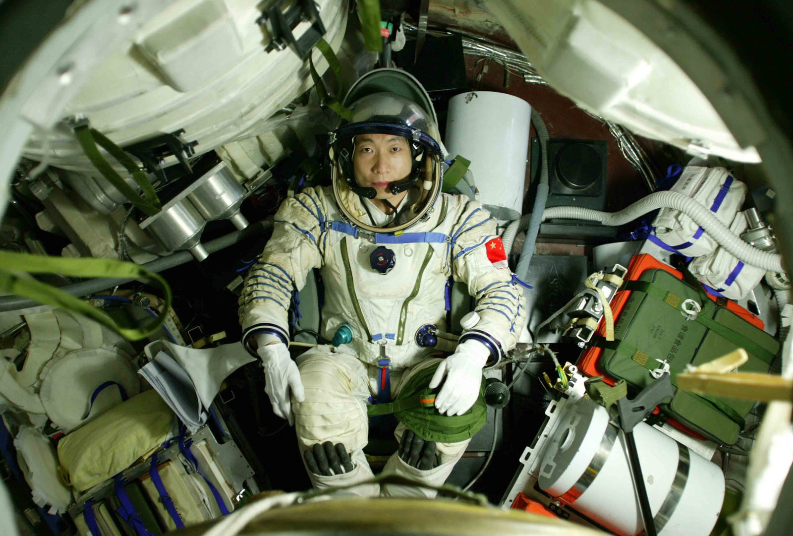 2003 Astronaut Yang Liwei lies in the re-entry capsule of the Shenzhou-5 spacecraft during training on Sept. 27, 2003, in Beijing.