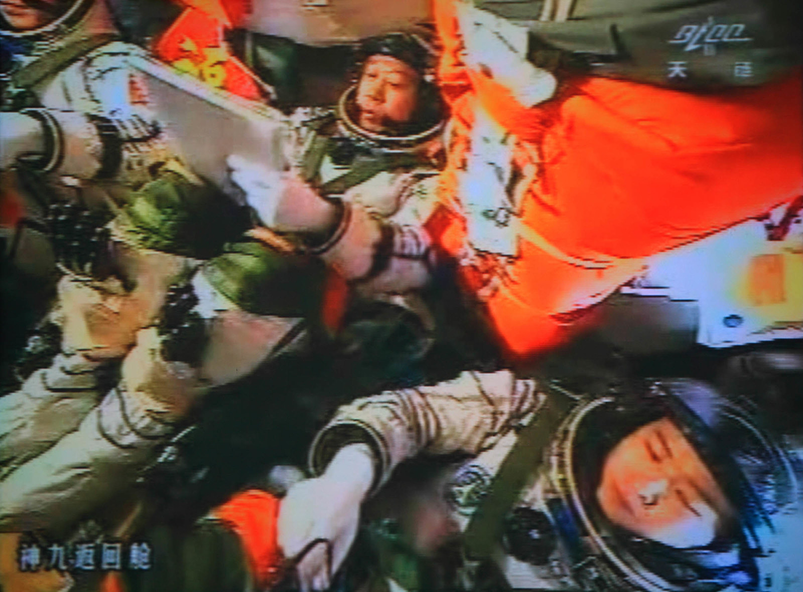 2012 A photo of the giant screen at the Jiuquan space center shows three Chinese astronauts (from left) Liu Wang, Jing Haipeng, and Liu Yang in the Shenzhou-9 spacecraft in preparation for docking with the Tiangong-1 module on July 18, 2012. Three Chinese astronauts entered an orbiting module for the first time, a key step towards the nation's first space station, in a move broadcast live on China's state television network. China aims to complete construction of a space station by 2020, a goal that requires it to have perfect docking technology.