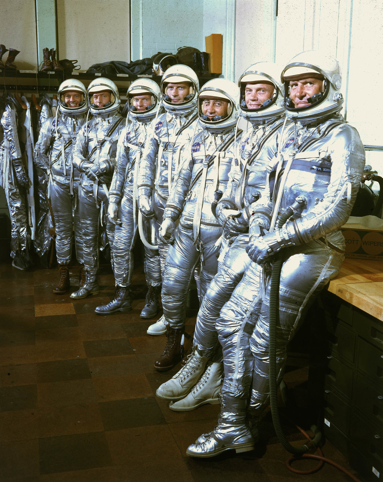 1960 Portrait of the initial seven Project Mercury astronauts as they pose in pressure suits at Langley Air Force Base, Virginia, March 17, 1960. Pictured are (from left) US astronauts Walter M. Schirra, John Glenn, Virgil I. Grissom, Donald K. Slayton, Gordon Cooper, Scott Carpenter, and Alan B. Shepard.