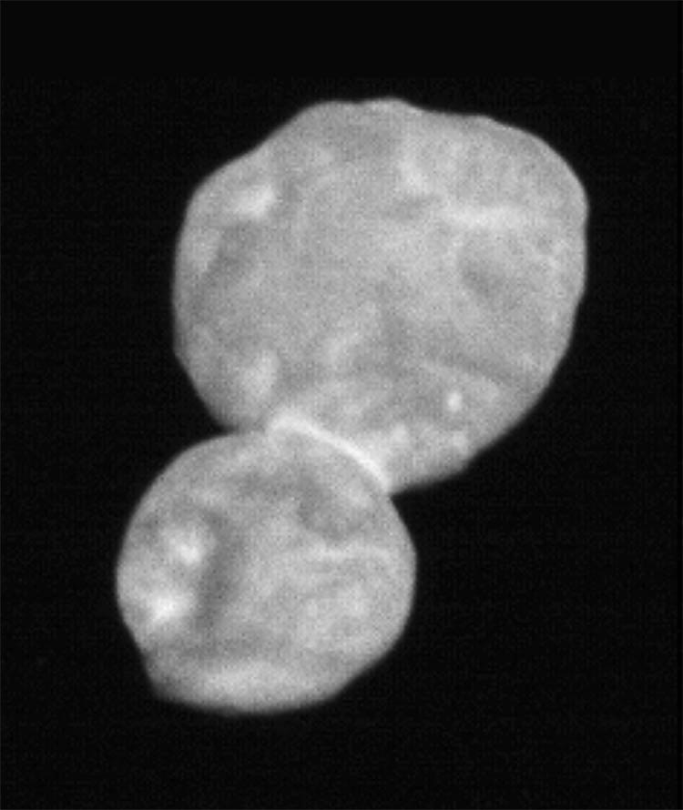 "2019 In this handout photo provided by NASA, the object nicknamed ""Ultima Thule"" is photographed by the Long-Range Reconnaissance Imager (LORRI) on the New Horizons spacecraft on Jan. 1, 2019. It was taken just 30 minutes before closest approach from a range of 18,000 miles. The object, the most distant ever explored, is known as a ""contact binary"". It likely began as two separate objects that joined together over time."