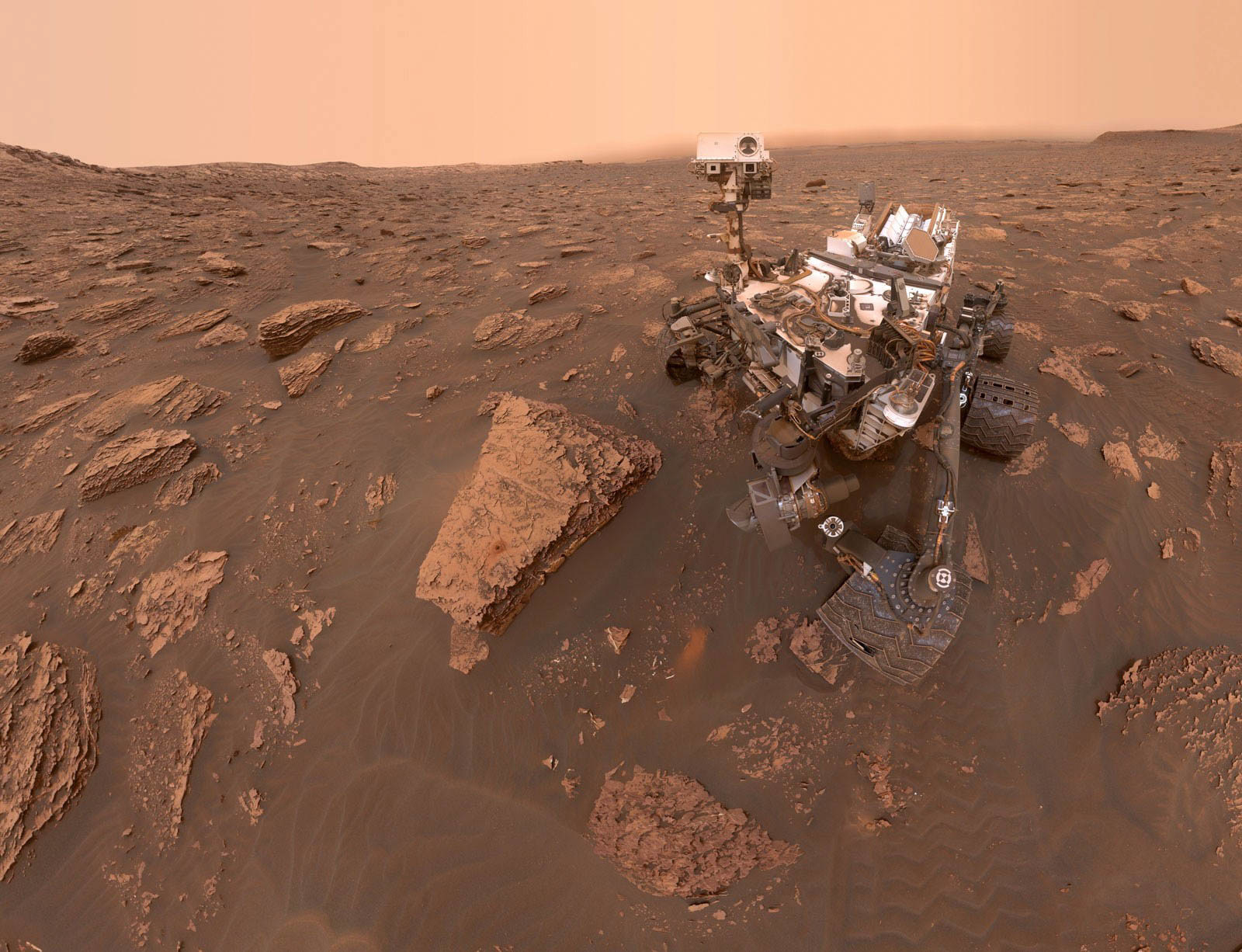"2018 A self-portrait of NASA's Curiosity Mars rover shows the robot at a drilled sample site called ""Duluth"" on the lower slopes of Mount Sharp in Mars on June 20, 2018. A Martian dust storm reduced sunlight and visibility in Gale Crater. The north-northeast wall and rim of the crater lie beyond the rover, their visibility obscured by atmospheric dust."