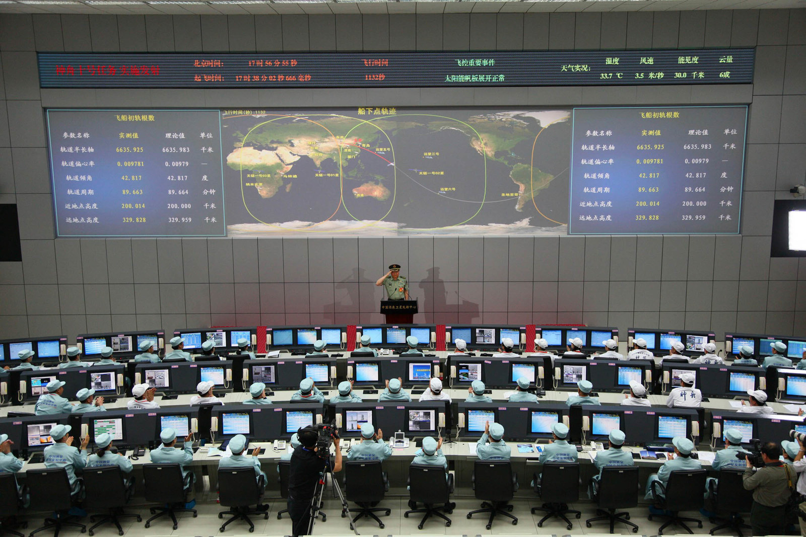 2013 Chinese chief mission commander Zhang Youxia salutes after he announced the successful launch of the Shenzhou-10 rocket from the Jiuquan space centre in the Gobi Desert in Jiuquan, in northwest China's Gansu Province on June 11, 2013. China began its longest manned space mission yet on June 11 with the launch of the Shenzhou-10, state television showed, as the country stepped up an ambitious exploration programme symbolising its growing power.
