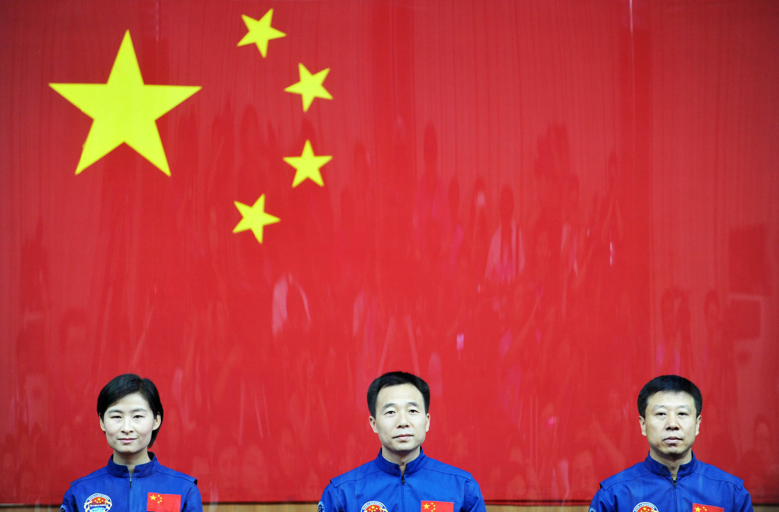 2012 Taikonauts Liu Yang, Jing Haipeng, and Liu Wang attend a press conference at the Jiuquan Satellite Launch Center on June 15, 2012, in Jiuquan, China. The Shenzhou-9 manned spacecraft carrying three crew members launched at 6:37 p.m. on June 16, performing the country's first manned space docking mission with the orbiting Tiangong-1 unmanned space lab.