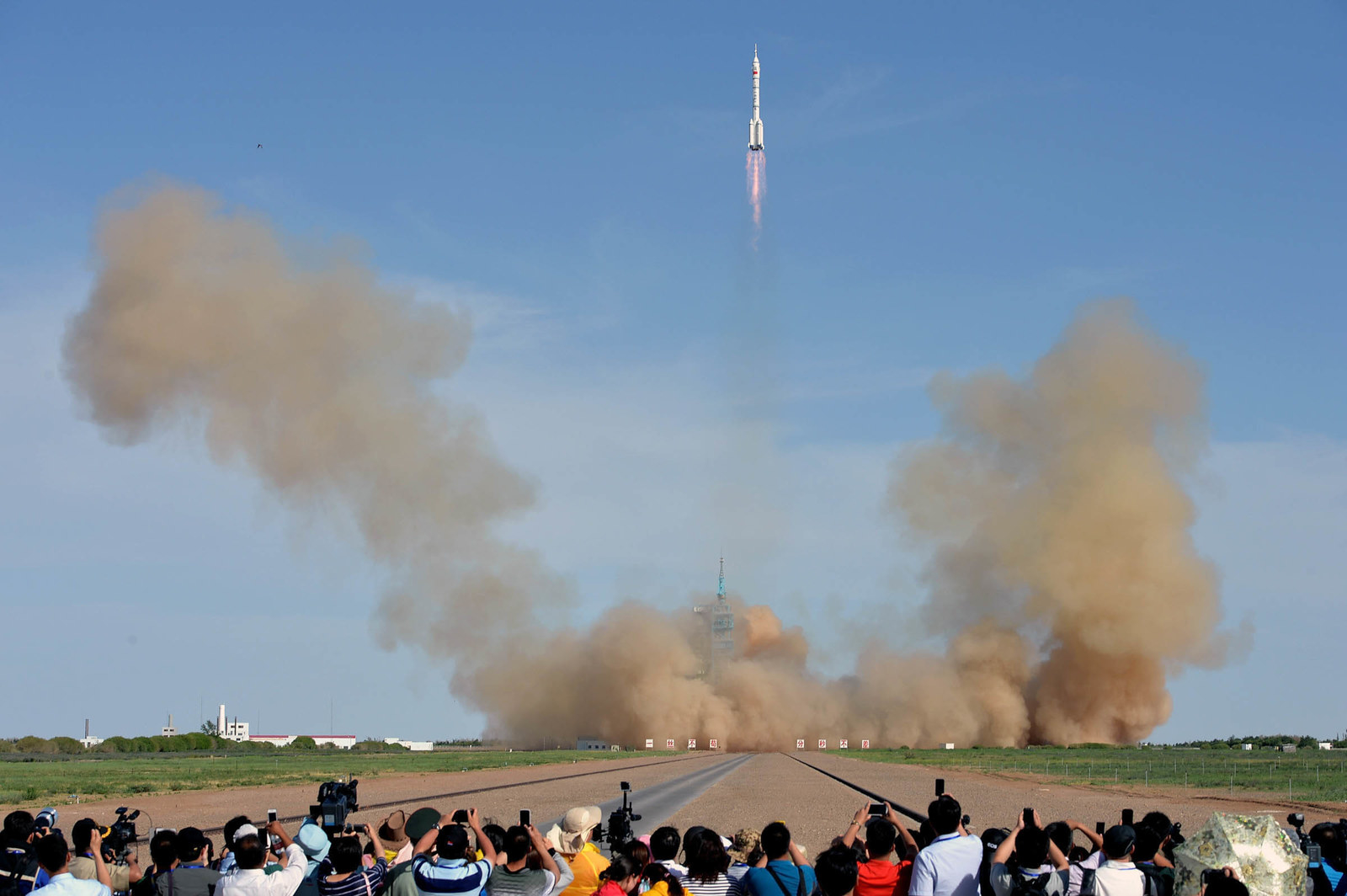 2013 The Long March 2F rocket carrying China's manned Shenzhou-10 spacecraft blasts off from a launch pad at Jiuquan Satellite Launch Center on June 11, 2013, in Jiuquan, Gansu Province. China's latest manned spacecraft blasted off on a 15-day mission to dock with a space lab.