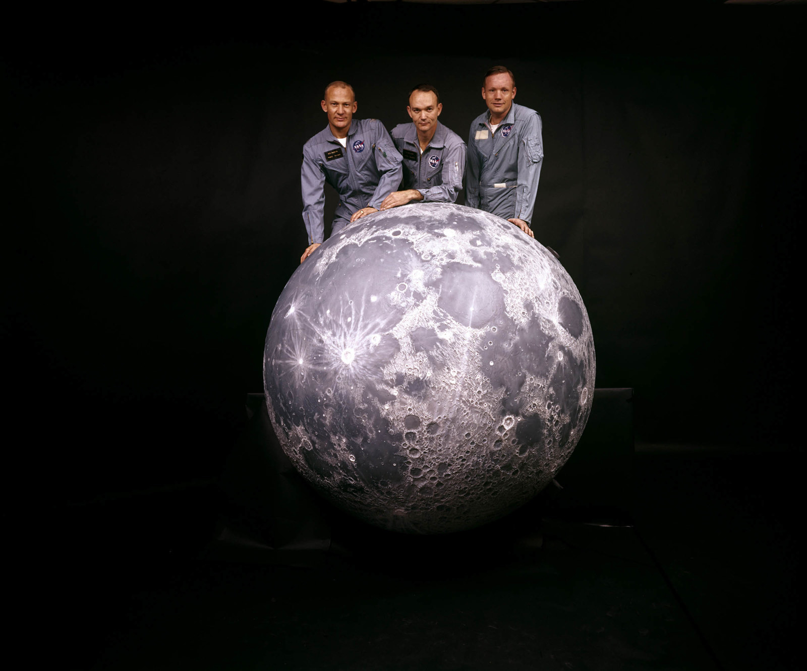 1969 Portrait of (from left) Aldrin, Collins, and Armstrong, the crew of NASA's Apollo 11 mission to the moon, as they pose on a model of the moon.