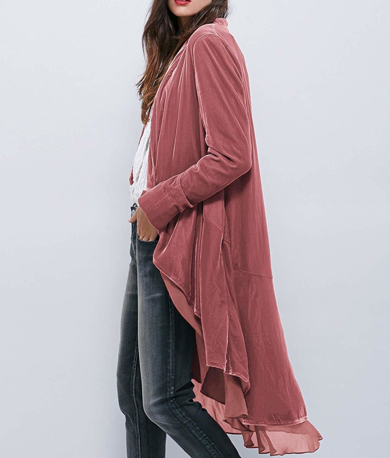 A model in the dusty pink high-low jacket