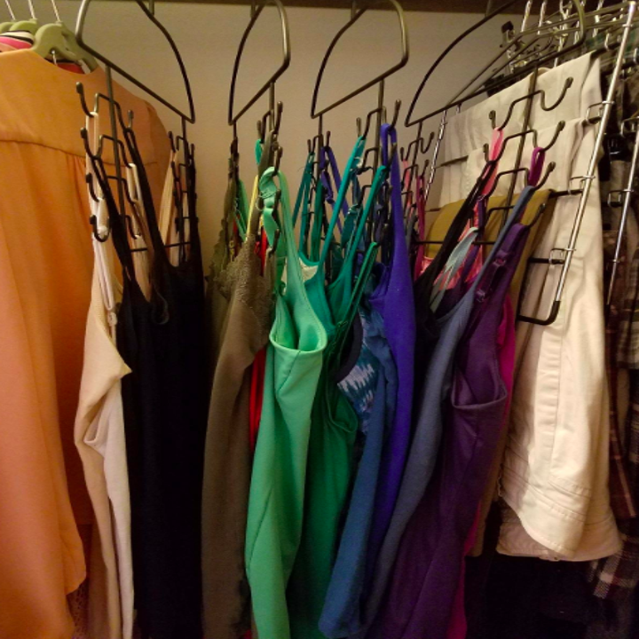A side-view customer review photo of the Tank Top Hangers holding all their tops
