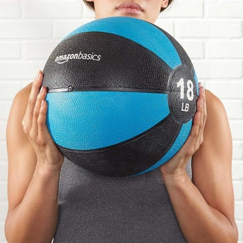 a model holding the ball in blue and black