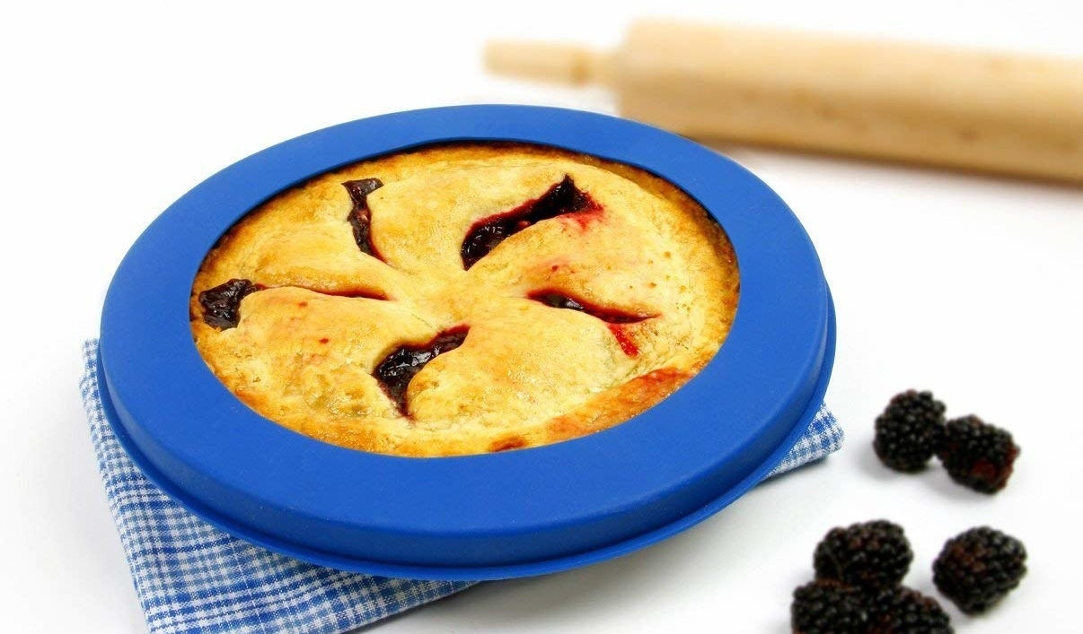 """Fits up to a 10"""" pie pan.Get it from Walmart or Jet for $6.94."""