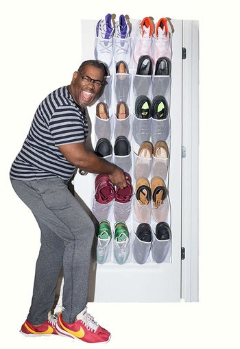 A person placing shoes in the hanging organizer