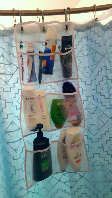 A customer review photo of the shower curtain caddy