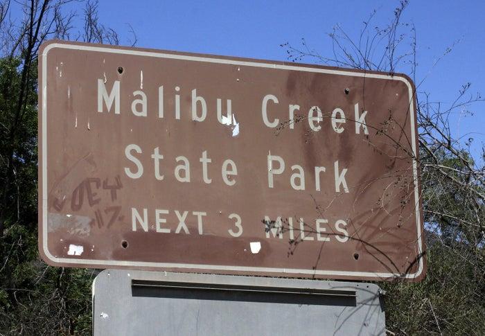 A sign directs motorists to Malibu Creek State Park near Calabasas, California.