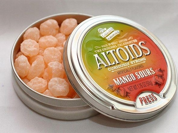 A tin of Mango Sours Altoids opened