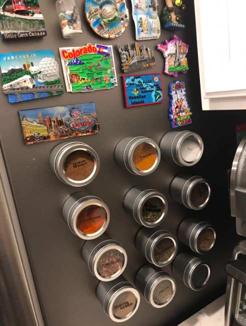 A customer review photo of the magnetic spice containers on their fridge