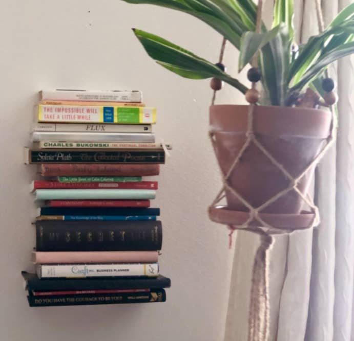 """Promising review: """"These are absolutely fantastic. They also come with all the materials (minus screwdriver) you need to hang them, they're very durable (I put about five hardcover novels on each) and I could probably put a few more on."""" —Laura Get a pack of four from Amazon for $23.99."""