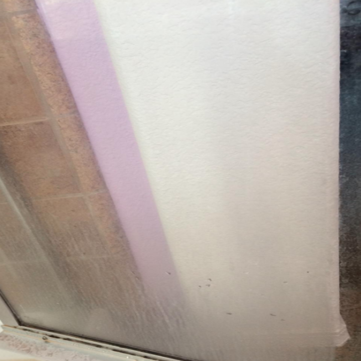before: a reviewer's glass shower door cloudy with mineral residue buildup