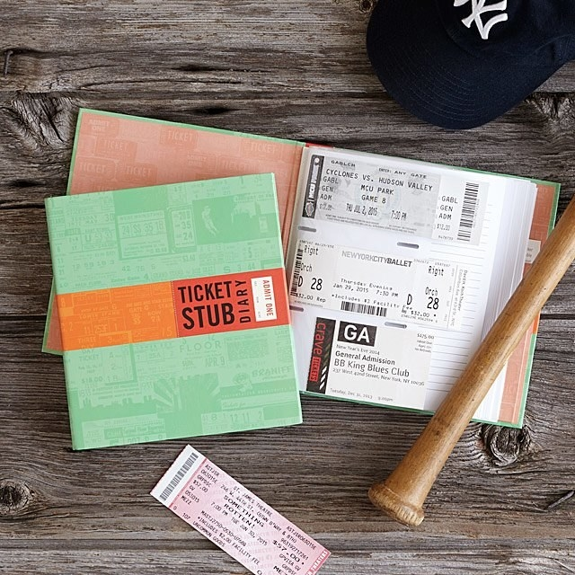 the diary opened to reveal different ticket stubs