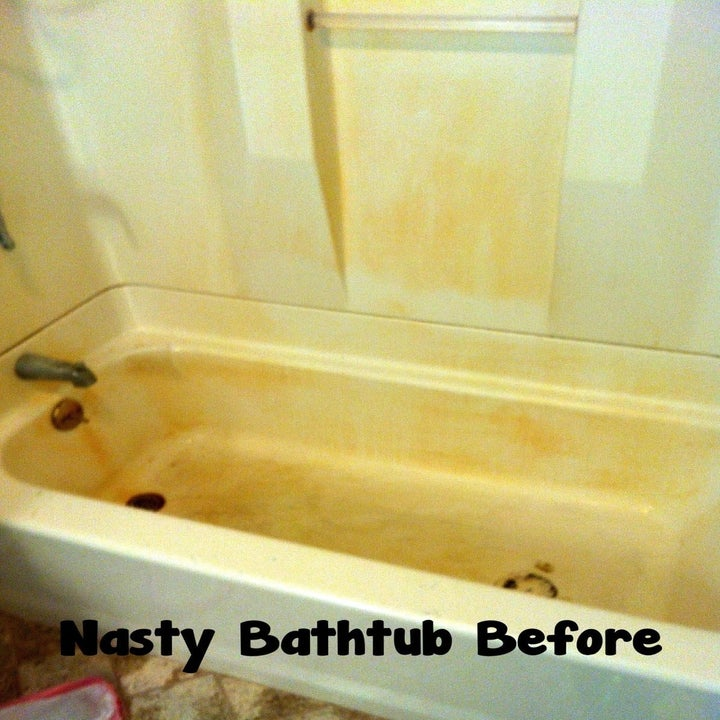 before: rust-stained bathtub