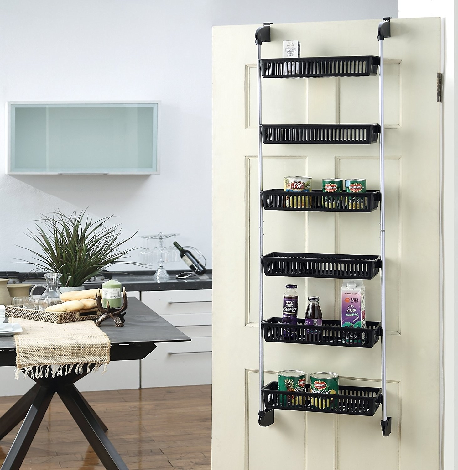 "Promising review: ""I wanted to organize my food pantry and saw this would allow me to utilize closet space more efficiently. It was easy to assemble and is perfect for my pantry! I was skeptical at first because the baskets are plastic, but don't let that fool you. One basket can hold several cans and it is very sturdy. I would highly recommend this to anyone."" —MWittyGet it from Amazon for $17.81."