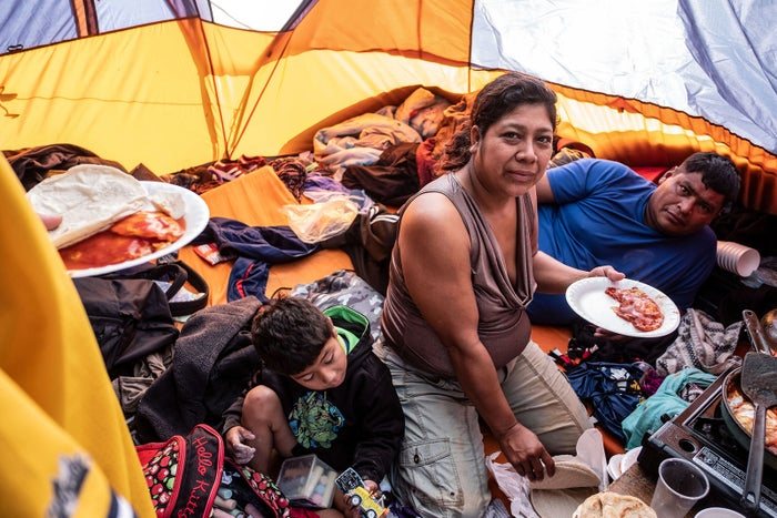 Members of a Salvadoran family inside their tent in downtown Tijuana, Mexico, on Dec. 18.