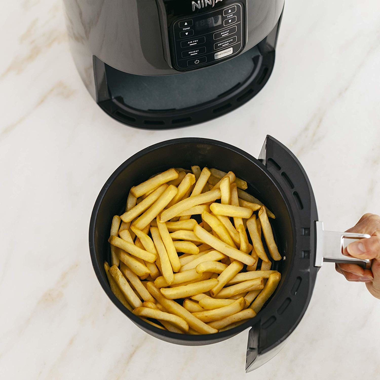 "This can help you satisfy your fried food cravings at home, except by using air circulation and a TINY amount of oil!Promising review: ""So far I love it and more importantly my husband does. At first he laughed at yet another kitchen appliance. But now he's using it daily and ready to retire his deep fryer. This is so much cleaner, healthier, and faster. I told him I need to purchase another one for his and her air fryers. 😊"" —AlliecatkatieGet it from Amazon for $99."