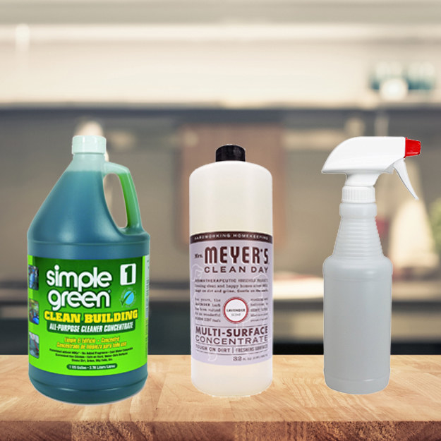 simple green gallon, mrs meyers refill bottle, and spray bottle sitting on kitchen cabinet