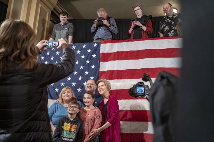 Elizabeth Warren takes a picture with Daniel and Molly Kueffer and their children at an organizing event in Sioux City, Iowa.