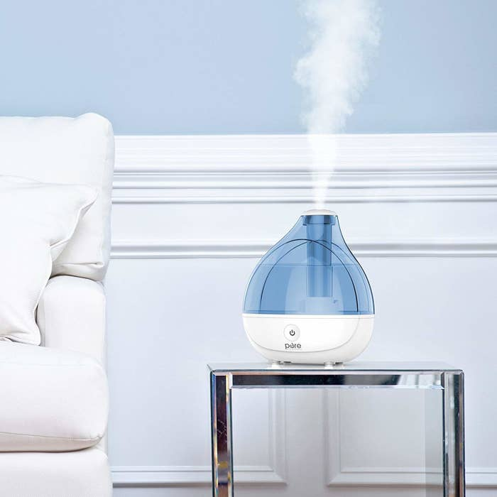 the humidifier on a side table in a living room