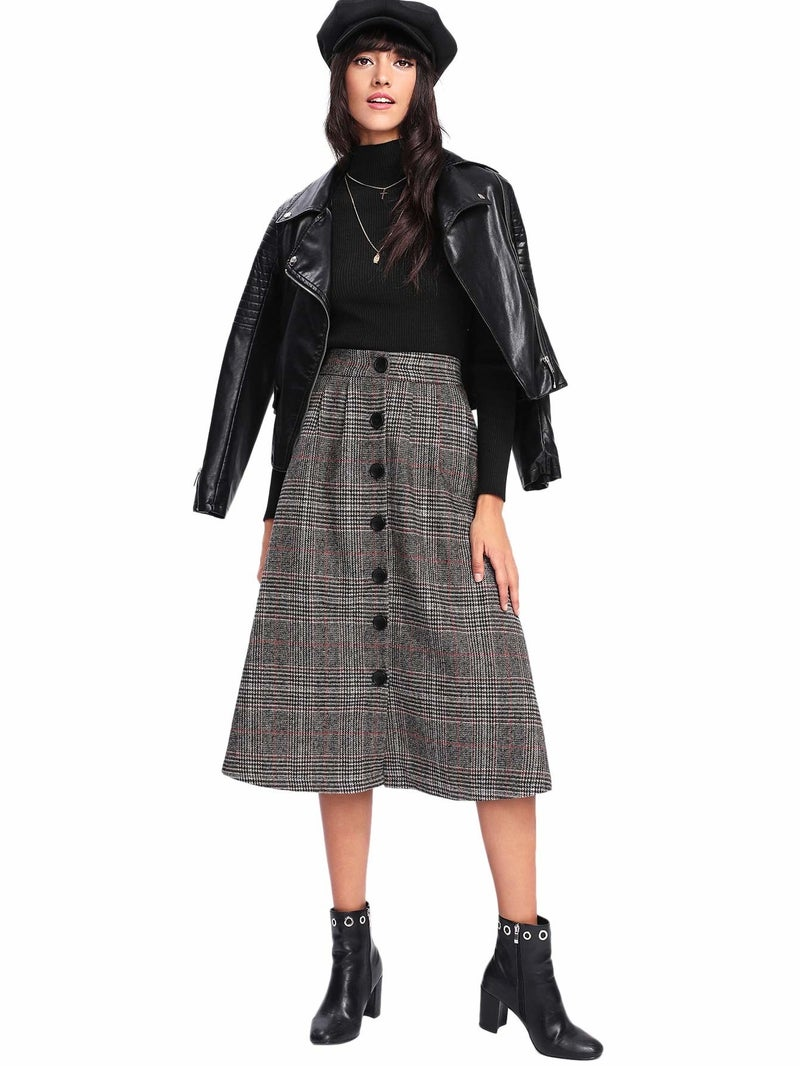 """Promising review: """"The material has a good weight and there's a red lining. It sits at my waist and hits above the ankles, which I love. I wore pantyhose and over-the-knee boots, and I was plenty warm on what was a pretty cold day in Chicago. I definitely recommend this skirt!"""" —Alexandra H.Get it from Amazon for $16.99+ (available in sizes XS-L and four styles)"""
