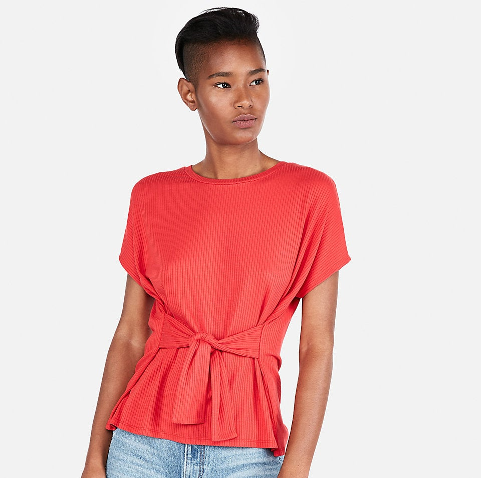 """Promising review: """"I've been looking for a basic T-shirt style top that would be a little dressier and this is just perfect. I tried on both the L and the XL and ultimately decided to go with the XL. I think it drapes really beautifully in the back and the cinching at the waist is incredibly pretty. I bought it in far too many colors. It is super soft, too!"""" —Express CustomerGet it from Express for $20.99 (originally $44.90; available in sizes XXS-XXL and four colors)."""