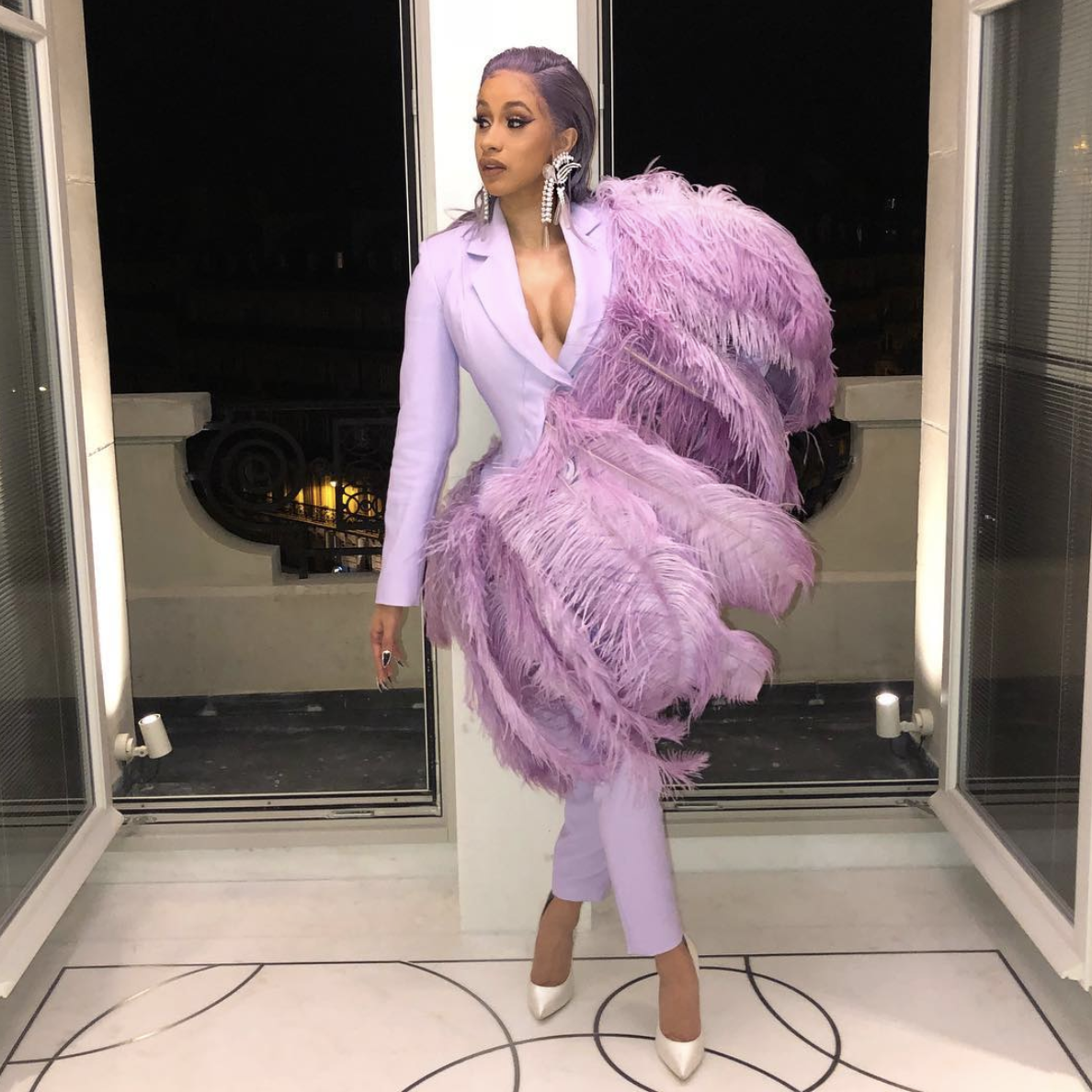 And leave it to Cardi to upstage Big Bird with this incredible feathered pantsuit and matching hair combo.