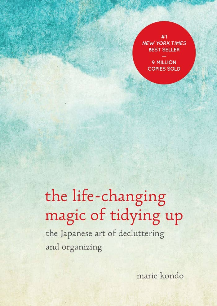 "The cover with the title, the subtitle ""the Japanese art of decluttering and organizing"", and the author, Marie Kondo"
