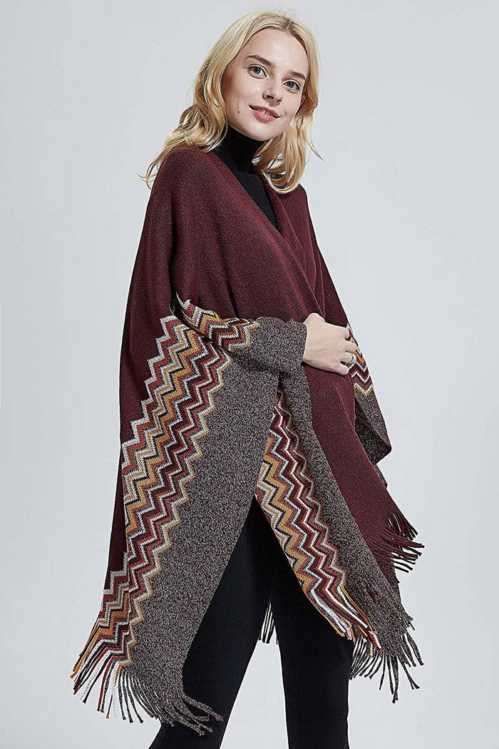 c40a5fd532a85 A cashmere-like poncho, because you'll be able to keep warm in the office  AND never ruin your outfit. Not all heroes wear capes, but this looks a lot  like ...