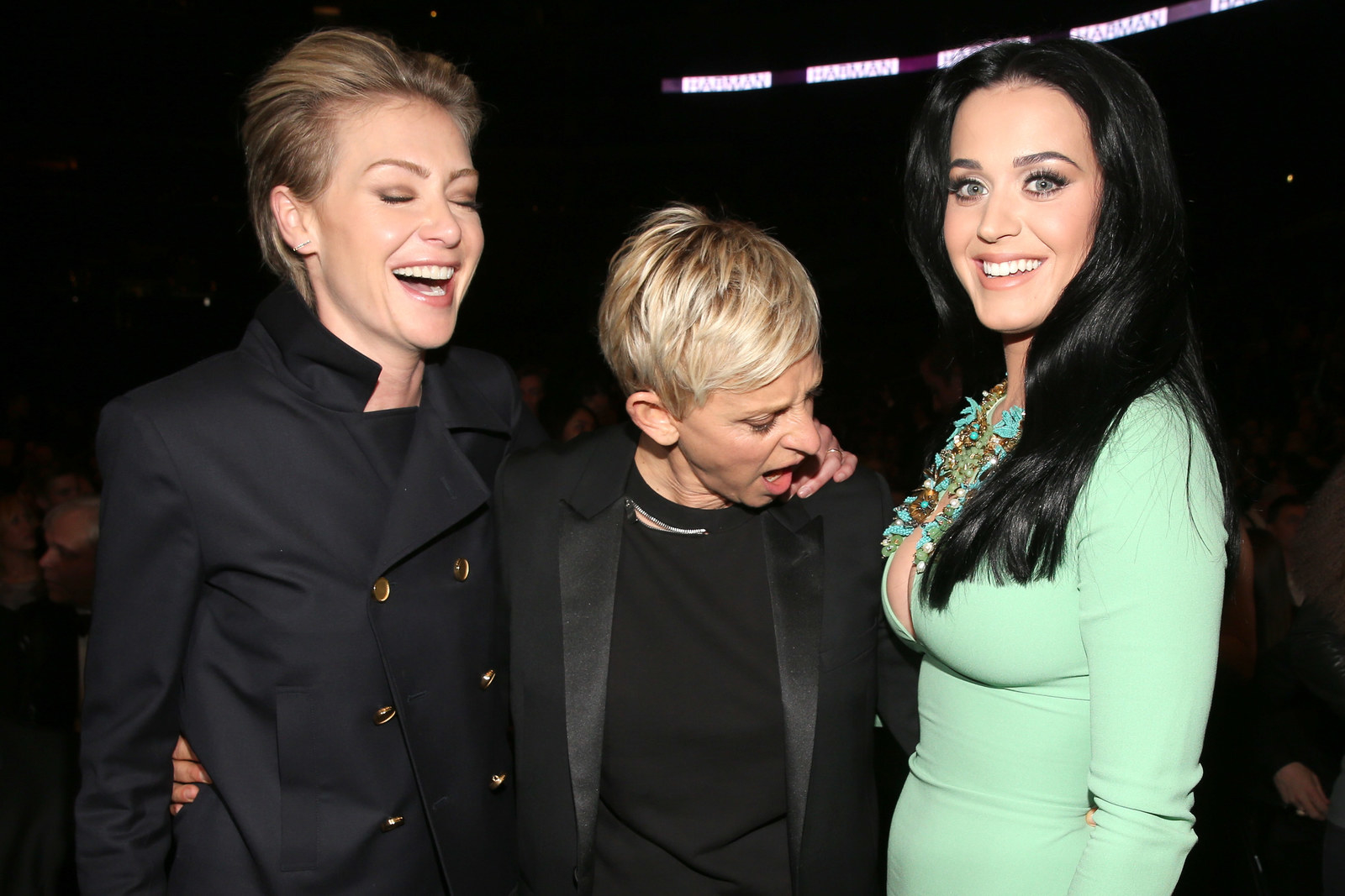 Portia de Rossi, DeGeneres, and Katy Perry at the Grammy Awards in 2013.
