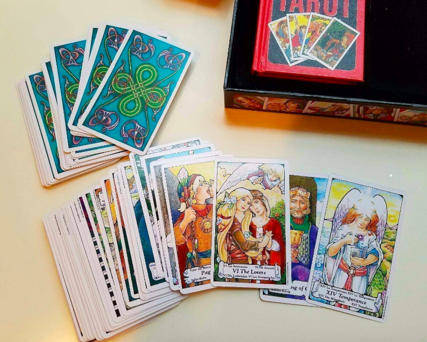 reviewer image of the tarot card set spread out on table