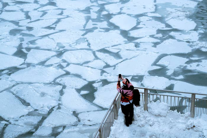 A pedestrian stops to take a photo by the Chicago River, as a bitter cold phenomenon called the polar vortex has descended on much of the central and eastern United States, in Chicago, Jan. 29.