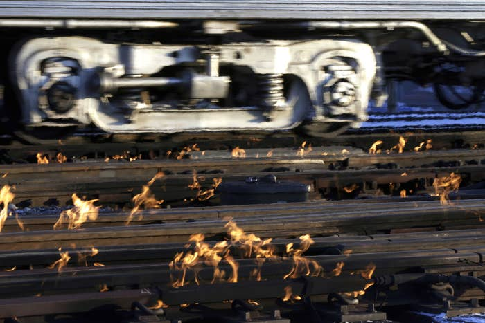 A Metra train moves southbound to downtown Chicago as the gas-fired switch heater on the rails keeps the ice and snow off the switches, Jan. 29.