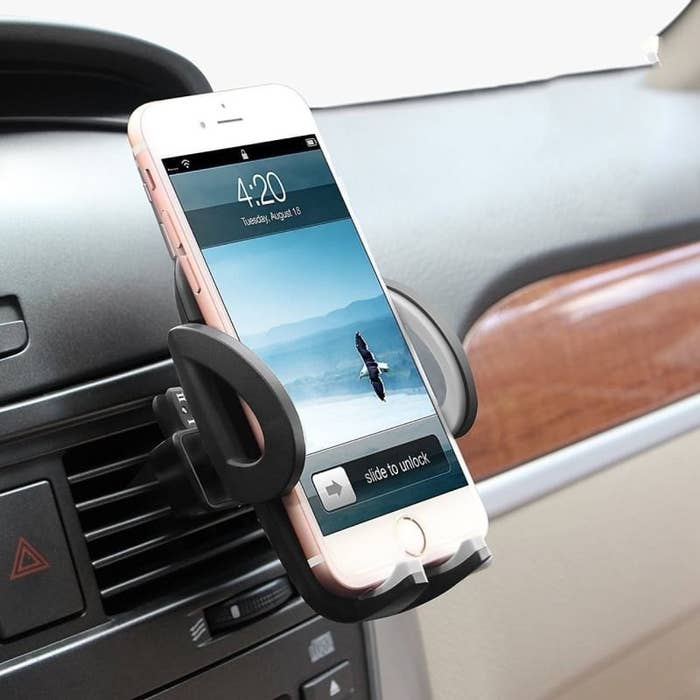 A phone holder attached to the car vent
